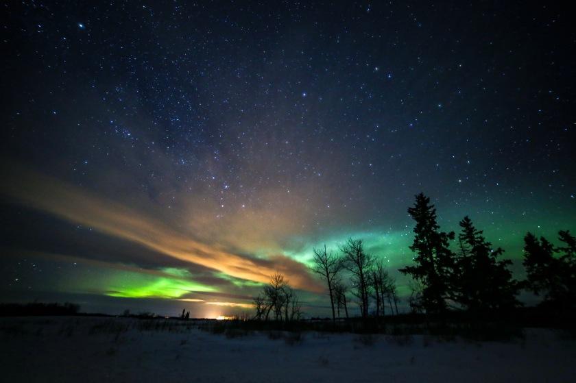 Aurora Borealis and Clouds glowing in Saskatchewan Canada
