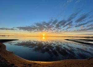 Beach at sunrise at good spirit lake