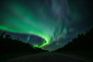 Northern lights over highway in Saskatchewan